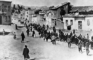 Armenians are marched to a prison by armed Ottoman soldiers, in Mezireh, Kharpert, Ottoman Empire, April 1915 Photo US Red Cross