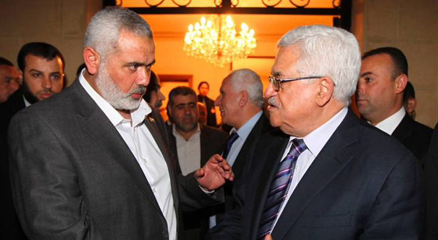 Palestinian President Mahmoud Abbas (right) with Hamas leader Ismail Haniyeh during a meeting between Fatah and Hamas in Cairo, Egypt, on 23 February, 2012 / Photo HH