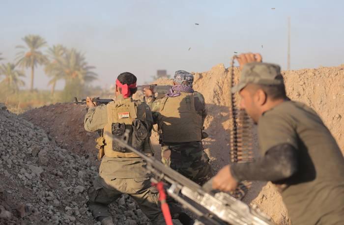 Iraqi_troops_vs_IS_250fd83739