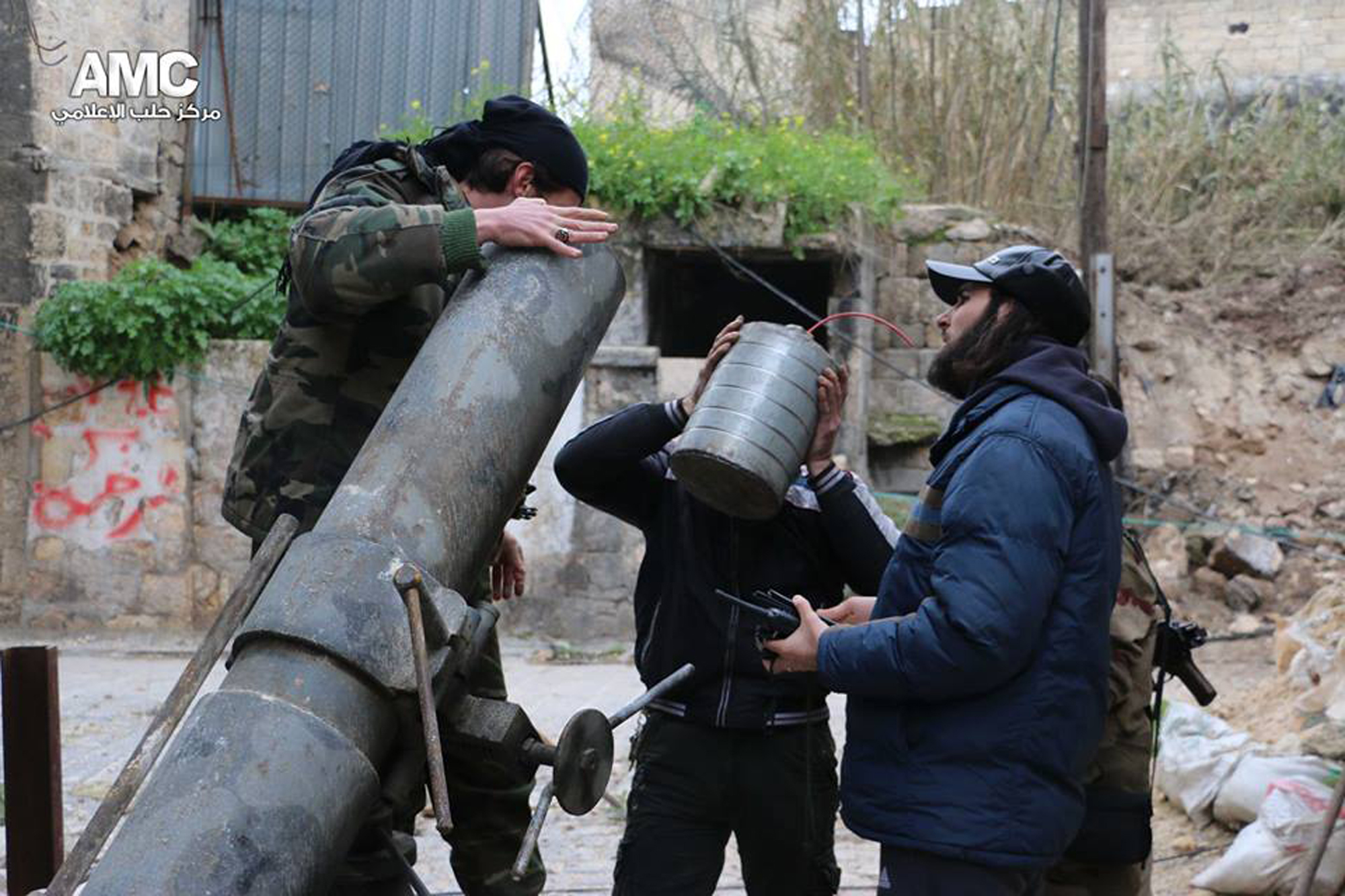 Syrian rebeles fire against government forces