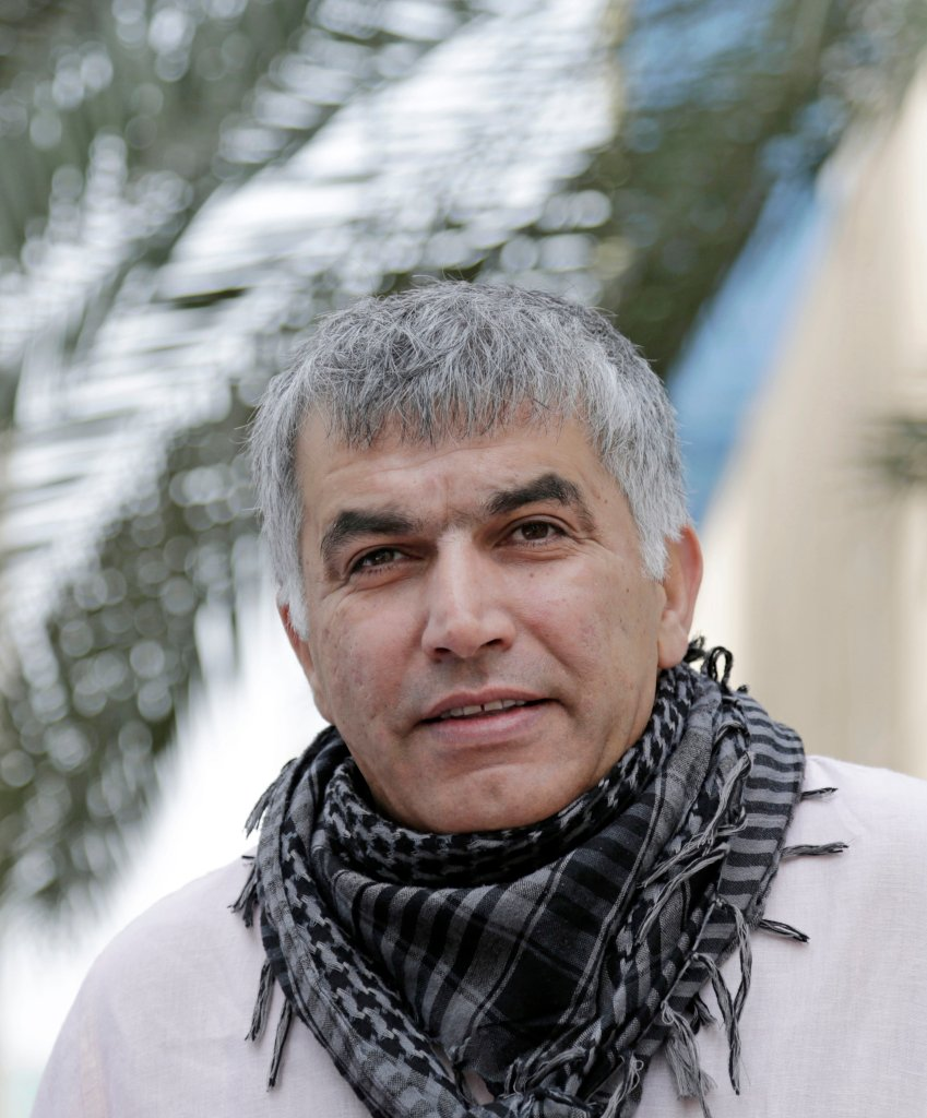 Nabeel Rajab, one of Bahrain's best-known human rights activists, walks toward the courthouse to attend his appeal hearing in Manama, Bahrain, Wednesday, Feb. 11, 2015,. Rajab was sentenced to six months in jail last month for insulting government ministries on Twitter, but has been free on bail pending his appeal. (AP Photo/Hasan Jamali)