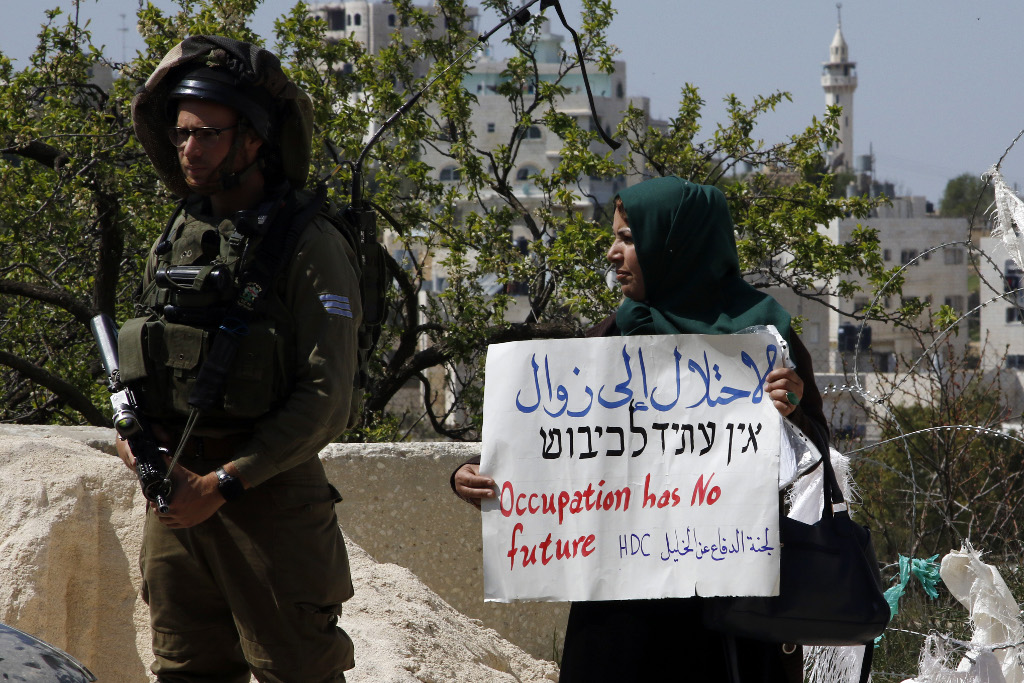 Israel and Palestine protest against Israli settlements