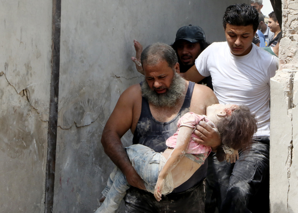 Syrian war Civil defence members carry wounded and dead people