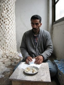 Palestinian man wrapping soap