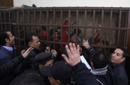 January 12, 2015 - Cairo, Egypt: Defendants react behind the bars at a court following the acquittal of 26 men accused of 'debauchery' after they were arrested in a night-time raid on a bathhouse in the Egyptian capital last month that triggered international concern. The men were arrested on Dec/ 7 in the raid on a hammam in the Azbakeya district of Cairo, amid fears of a widening police crackdown on homosexuals in Egypt even though Egyptian law does not expressly ban homosexuality. (Amr Sayed/APAImages/Polaris)