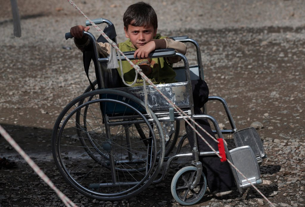 syrian war disabled syrian refugee boy sits on weelchair
